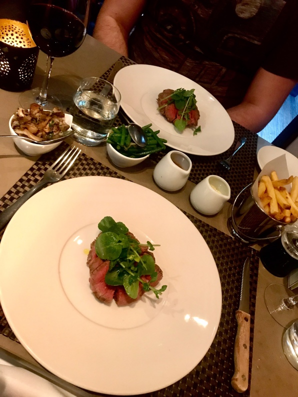 Chateaubriand with: green beans, garlic and shallots; wild mushrooms and garlic; chips; garlic butter sauce; peppercorn sauce