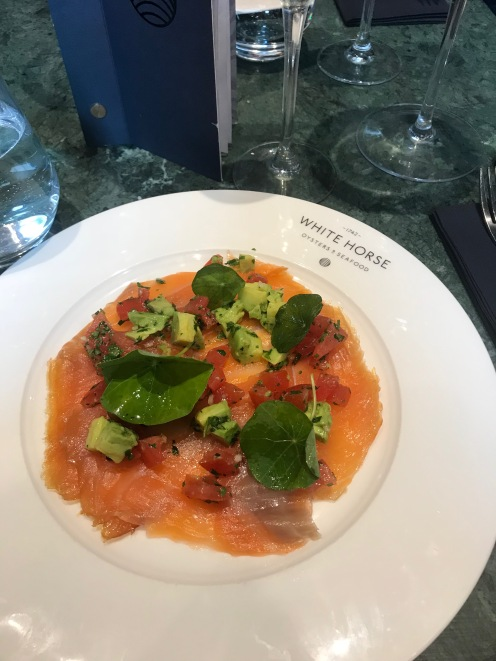 Scotch bonnet cured salmon with avocado and heritage tomatoes